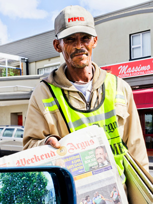 Street vendor selling the newspaper