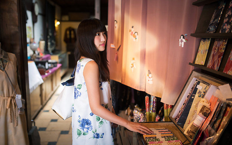 Young woman shopping in a traditional Japanese retail store