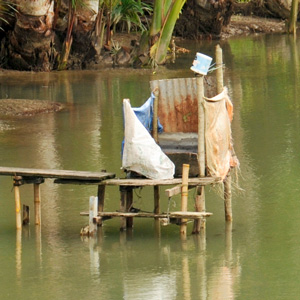 A tropical toilet above the river.