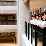 Japanese schoolgirls, on the first floor, overlooking the atrium.