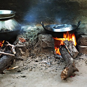 Pots simmering on a wood-burning mud stove.