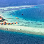 Aerial view of the Maayafushi Resort island, in Maldives.