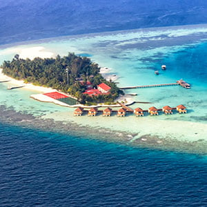 Aerial view of a vacation island resort, in Maayafushi, Maldives.