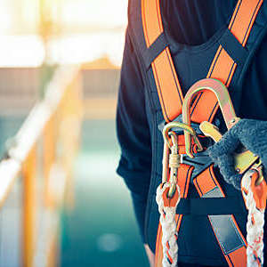 Close-up of construction worker's safety harness and safety line.