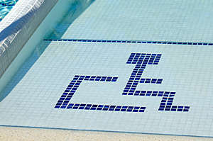 Accessible swimming pool with wheelchair symbol.