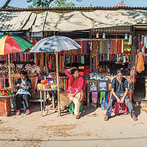 Colourful market stalls and traders selling souvenirs, on a the road in Kathmandu, Nepal.