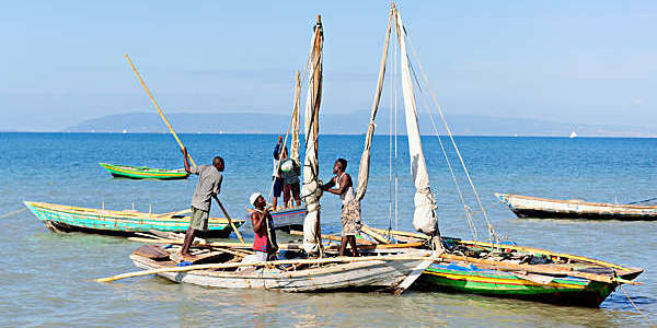 Haitian fishermen preparing their boats for a day's work.