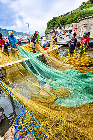 Fishermen preparing nets and boats for fishing in Venezuela.