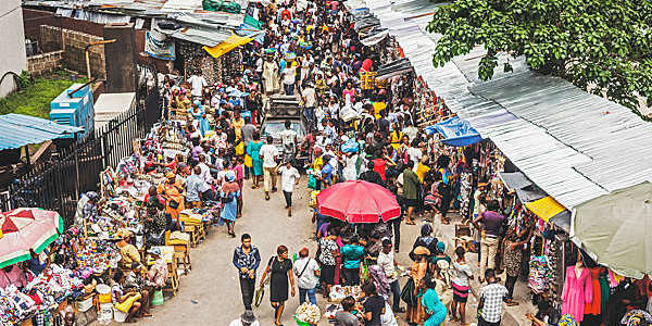 Street market crowd at Lagos Island's commercial district in Nigeria.