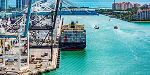 A container ship at the Port of Miami-Dade loaded and ready to set sail on an international journey.