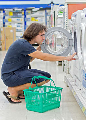 Man shopping for a combo washer-dryer.