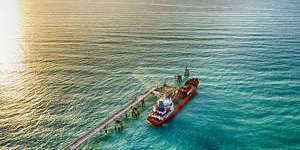 Aerial view of a chemical tanker waiting for loading.