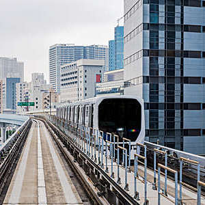 Autonomous monorail travels through the ultramodern Odaiba district in Tokyo Bay, Japan.