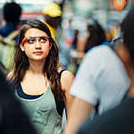 Teenage girl wearing Google Glasses, on Times Square.