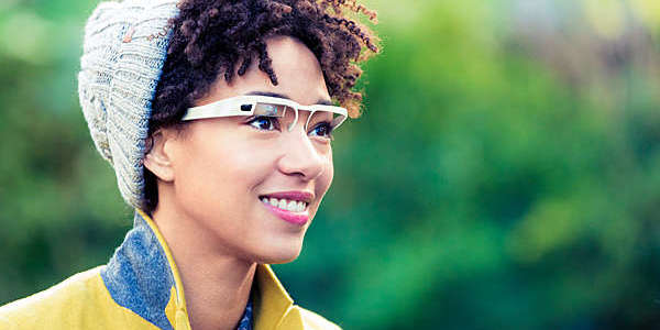 Woman with a wearable computer in the form of smart glasses.