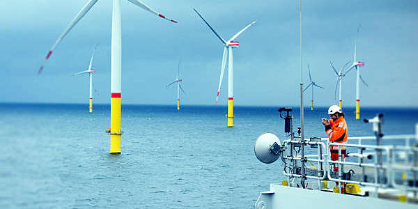 An electrician monitors the telecommunication system at an offshore wind farm.