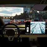 Automotive display system on car dashboard uses artificial intelligence to predict traffic flow.