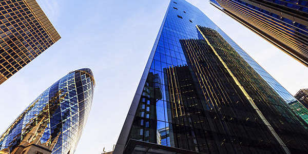 Low-angle view of buildings in London's financial district.