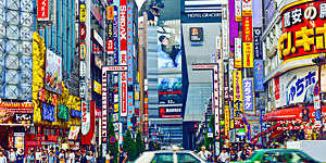 Colourful signs adorn buildings in the Shinjuku area of Tokyo, Japan.