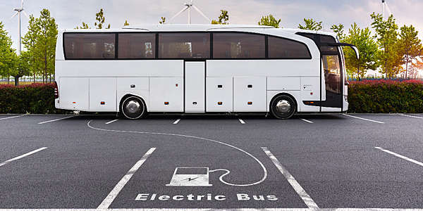 Electric bus on charge using pure energy from wind turbines.