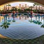 Rui Tourag hotel in the Cape Verde islands with its Moorish style architecture, palm trees and a tiled reflecting pool.
