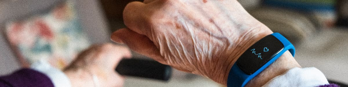 Elderly woman hand and detail of her smartwatch.