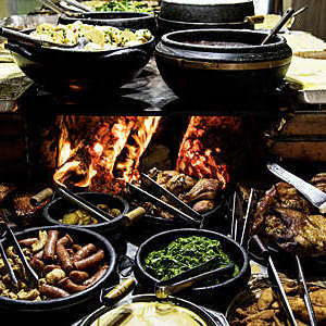 Typical dishes from Minas Gerais, Brazil, laid out in front of a wood stove.