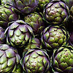 Full frame of purple italian artichokes.