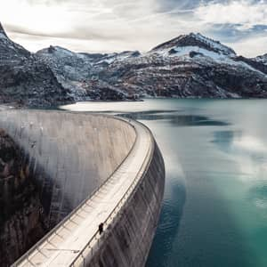 Emosson hydroelectric dam and lake surrounded by rocky landscape, in Switzerland.