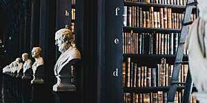 Vanishing perspective of marble busts lining the Long Room at the Old Library of Trinity College Dublin.