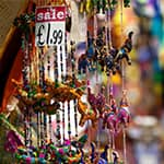 Close-up of sale price tag for beaded necklaces and other trinkets on a vendor's stall at Camden Market, London.