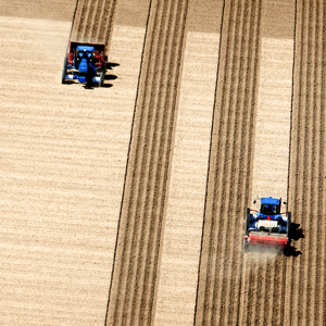 An aerial view of fields being plowed