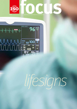 Cardiogram monitor in surgery while not recognizable doctor operates. The focus is on the screen
