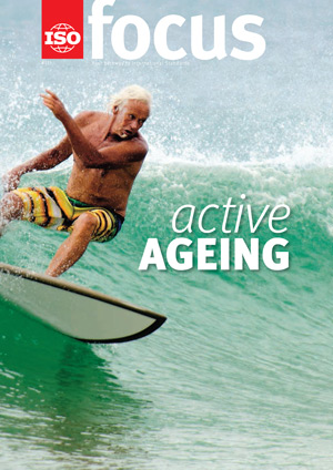 An elderly man wave surfing.
