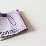 Close Up of a Bundle of 500 Euro Banknotes on a White Table